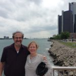 At a park along the RiverWalk in downtown Detroit. The Renaissance Center is in the background.