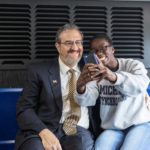 "Sharing a few laughs, stories and even posing for a ""selfie"" with U-M student Moji Igun"