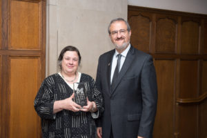 Louise Baldwin receives the 2017 President's Award for Distinguished Service in International Education from President Schlissel.