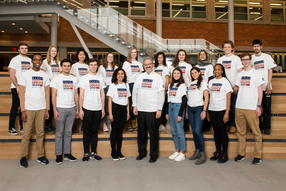 President Schlissel with student volunteers for the 2020 Presidential Debate in the LSA Building.